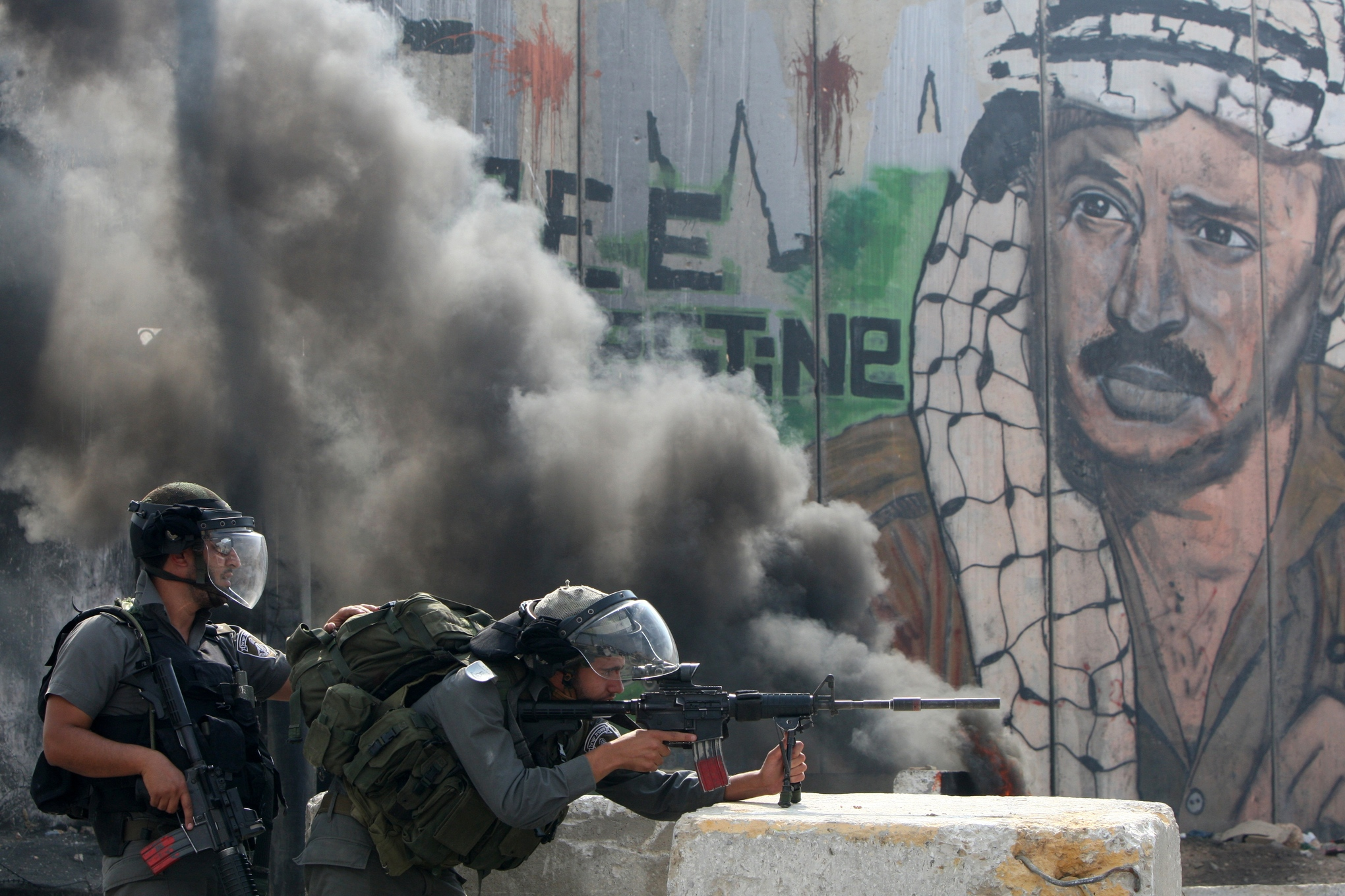 Israeli soldiers keep their position during clashes with Palestinian stone throwers at the Qalandia checkpoint between the West Bank city of Ramallah and Jerusalem on September 21, 2011. AFP PHOTO/AHMAD GHARABLI (Photo credit should read AHMAD GHARABLI/AFP/Getty Images)