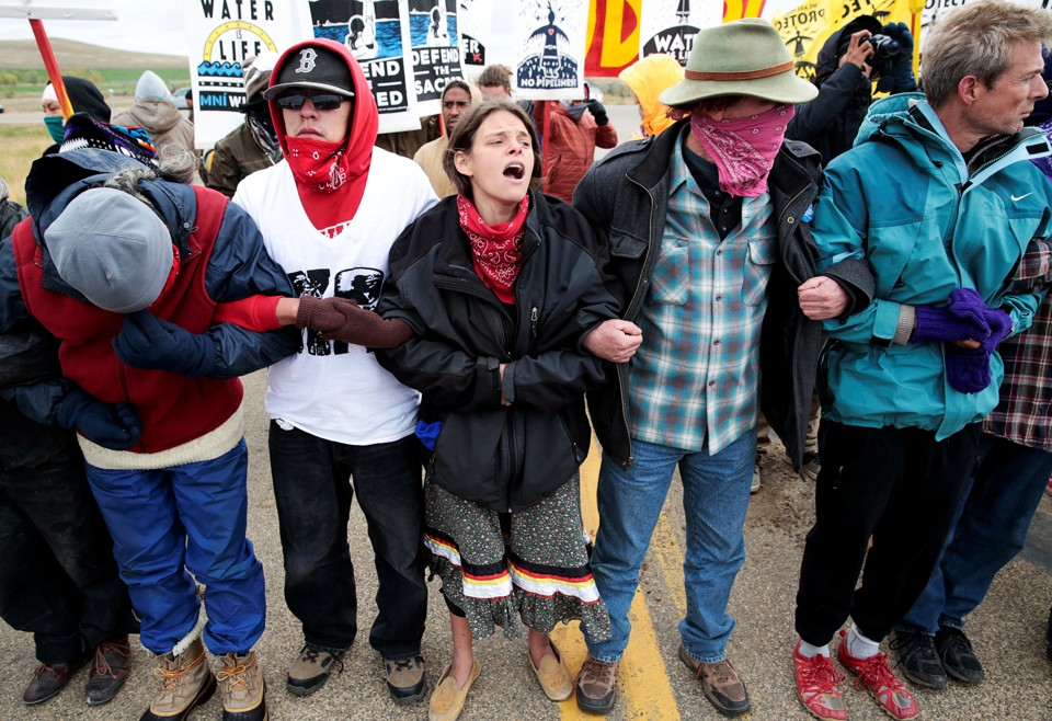 Dakota Access Pipeline protesters square off against police between the Standing Rock Reservation and the pipeline route outside the little town of Saint Anthony, North Dakota, U.S., October 5, 2016. REUTERS/Terray Sylvester          FOR EDITORIAL USE ONLY. NO RESALES. NO ARCHIVES. - RTSQY9T