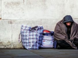 Homeless by a Wall