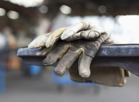 Close up of gloves in warehouse