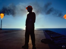 Oil Worker on Deck of Oil Drilling Platform --- Image by © Barry Lewis/Corbis