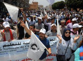Moroccan protesters shout slogans during a demonstration in downtown Rabat on June 11, 2017, demanding that authorities release the leaders of a protest movement that has rocked the neglected northern Rif region for months. An interior ministry source said between 12,000 and 15,000 people took part in the protest which was organised by several organisations including Morocco's most popular Islamist group. / AFP PHOTO / STRINGER